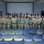 Members of the graduating class of St. Louis Metropolitan Police Academy on the completion of Law Enforcement and Society, with docents Sarijane Freiman and Lolle Boettcher, August 7, 2014.